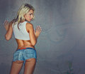 Beautiful Young Blonde Woman In Denim Shorts Royalty Free Stock Photography - 40452567