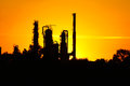 Silhouette Of  Oil Refinery Factory  Against Sunset Stock Photos - 40460863