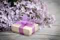 Gift Box With Purple Bow And Lilac On Wood Royalty Free Stock Photo - 40479245