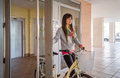 Girl With Fixie Bike Opening A Glass Door To Exit Stock Photography - 40495402