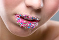 Beautiful Woman S Mouth Full Of Colorful Candies Royalty Free Stock Photography - 40519487