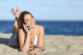 Pretty Teenager Girl On The Phone Lying On The Beach Royalty Free Stock Image - 40520466