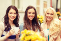 Three Beautiful Girls Drinking Coffee In Cafe Royalty Free Stock Photos - 40530128