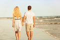 Beach Couple Holding Hands Walking At Sunset Stock Photography - 40540172