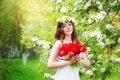 Portrait Of A Beautiful Young Woman In A Wreath Of Spring Flower Stock Images - 40560594