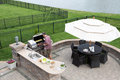 Man Cooking Meat On A Gas BBQ Stock Images - 40564074