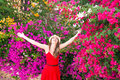 Happy Woman Is Standing Among Beautiful Colorful Flowers. Stock Photo - 40579760