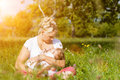 Mother Nursing Baby On Meadow Stock Image - 40585721