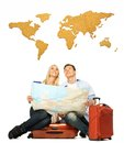 Couple With A Map Sitting On A Suitcase Stock Photos - 40594333