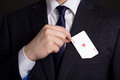 Mans Hand Hiding Playing Card In Suit Pocket Royalty Free Stock Photography - 40595117