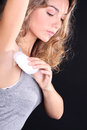 Woman With Roll-on Deodorant Stock Images - 40597554