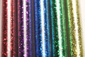 Picture Of Set Five Colors Of Glitters In Glass Jars - Red, Purple, Blue, Green, Gold (yellow) Royalty Free Stock Images - 40599959