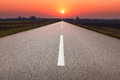 Driving On Asphalt Road Towards The Setting Sun Royalty Free Stock Images - 40600709