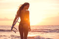 Silhouette Surfer Girl On The Beach At Sunset Royalty Free Stock Photo - 40623305