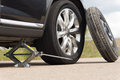 Jacking Up A Car To Change A Tyre Royalty Free Stock Images - 40625049