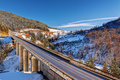 Mountain Bridge In Winter With Snow And Blue Sky Stock Images - 40626264