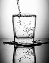 Pouring Water To Glass Royalty Free Stock Photos - 40724238