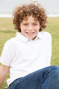 Smiling Young Boy Posing Casually Royalty Free Stock Image - 40740476