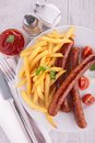 Grilled Sausages And French Fries Royalty Free Stock Images - 40747729