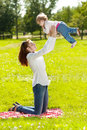 Beauty Mom And Baby Outdoors. Happy Family Playing In Nature. Mo Stock Photos - 40757023