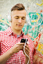Happy Handsome Man Enjoying His Music Stock Images - 40772464
