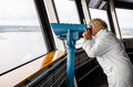 Woman Looking Through Binoculars From Nasinneula Tower Royalty Free Stock Images - 40794049