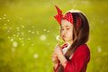 Beautiful Little Girl Blowing Dandelion Royalty Free Stock Image - 40810386