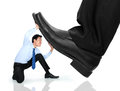 Little Business Man Being Crushed By The Feet Royalty Free Stock Photos - 40822638