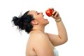 Overweight Girl Eating Red Apple. Royalty Free Stock Photography - 40833217