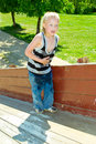 Boy Playing On A Wooden Slide Stock Image - 40867021