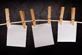 Three Blank Paper Notes Hanging On Rope With Clothes Pins Stock Images - 40881184