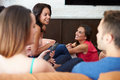 Group Of Friends Sitting On Sofa Watching TV Together Stock Photography - 40881562