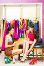 Asian Sales Lady In Shop Offering Shoes Royalty Free Stock Images - 40899129