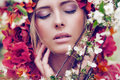 Sensual Blonde Woman With Flowers Royalty Free Stock Photography - 40907797