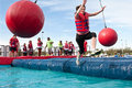 Woman Falls Into Water At Crazy Obstacle Course Race Stock Images - 40928504