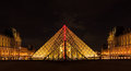 Louvre Museum And The Pyramid In Paris Royalty Free Stock Image - 40929716
