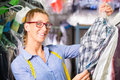 Cleaner In Laundry Shop Checking Clean Clothes Stock Photography - 40934962