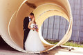 Bride And Groom Posing On Architectural Background Stock Photo - 40935880