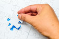 Person Fitting The Last Puzzle Piece Stock Image - 40936771