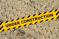 Tire Track In A Sand With Under Construction Yellow Tape Royalty Free Stock Images - 40940929