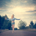 Beautiful Woman With Open Arms Under The Sunrise Royalty Free Stock Photo - 40951755