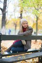 Sad Girl Sitting On A Bench In Park Royalty Free Stock Image - 40956866