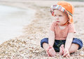 Cute Toddler Baby  Sitting On The Beach Stock Image - 40960001