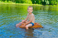Boy Floats On The River Stock Photography - 40968702