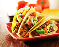 Three Beef Tacos With Cheese, Lettuce And Tomatoes Royalty Free Stock Image - 40979676