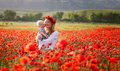 Woman With Baby In A Field Of Red Poppies Stock Photos - 40995893