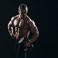Muscular Torso Man With Dumbbell On Black Background In Studio Stock Image - 41010751