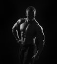 Muscular Man On Black Background In Studio Stock Photography - 41010752