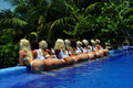 CANCUN, MEXICO - MAY 05: Models Pose By The Edge Of Pool For White T-shirt Project Royalty Free Stock Image - 41013236