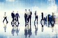Silhouettes Of Business People Walking Inside The Office Royalty Free Stock Photos - 41013528